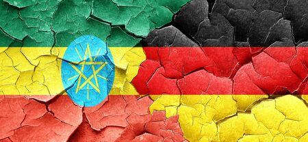 ethiopia  flag: Ethiopia flag with Germany flag on a grunge cracked wall