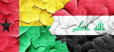 iraq war: Guinea bissau flag with Iraq flag on a grunge cracked wall