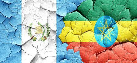 bandera de guatemala: bandera de Guatemala con la bandera de Etiopía en una pared agrietada grunge Foto de archivo