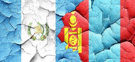 mongolia: guatemala flag with Mongolia flag on a grunge cracked wall