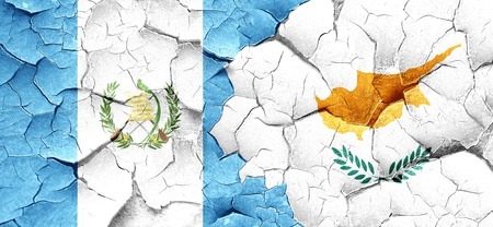 flag of guatemala: guatemala flag with Cyprus flag on a grunge cracked wall