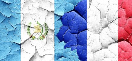 flag of guatemala: guatemala flag with France flag on a grunge cracked wall Foto de archivo