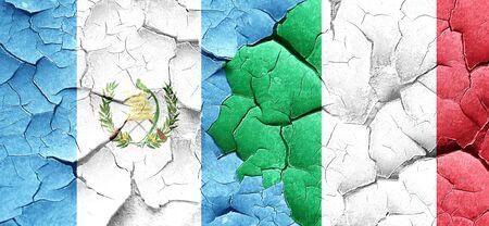 italian politics: guatemala flag with Italy flag on a grunge cracked wall