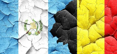 bandera de guatemala: bandera de Guatemala con la bandera de Bélgica en una pared agrietada grunge Foto de archivo