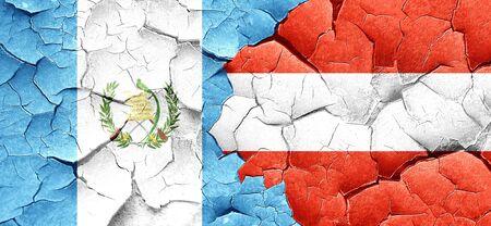 bandera de guatemala: guatemala flag with Austria flag on a grunge cracked wall Foto de archivo