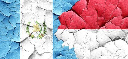 bandera de guatemala: bandera de Guatemala con la bandera de Indonesia en una pared agrietada grunge Foto de archivo