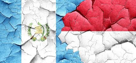 flag of guatemala: guatemala flag with Indonesia flag on a grunge cracked wall Foto de archivo
