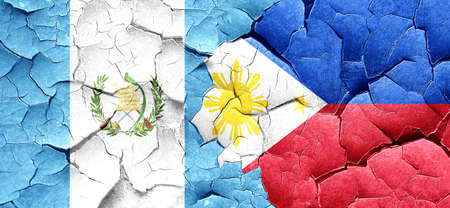 philippino: guatemala flag with Philippines flag on a grunge cracked wall Stock Photo