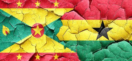 ghanese: Grenada flag with Ghana flag on a grunge cracked wall