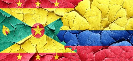 cracked wall: Grenada flag with Colombia flag on a grunge cracked wall Stock Photo