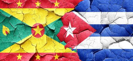 cracked wall: Grenada flag with cuba flag on a grunge cracked wall