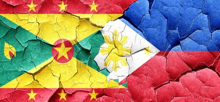 philippino: Grenada flag with Philippines flag on a grunge cracked wall Stock Photo