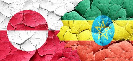 cracked wall: greenland flag with Ethiopia flag on a grunge cracked wall