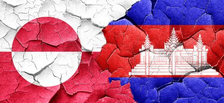 cambodian flag: greenland flag with Cambodia flag on a grunge cracked wall