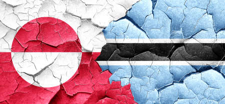 greenland: greenland flag with Botswana flag on a grunge cracked wall Stock Photo