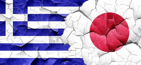 cracked wall: Greece flag with Japan flag on a grunge cracked wall Stock Photo