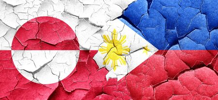philippino: greenland flag with Philippines flag on a grunge cracked wall