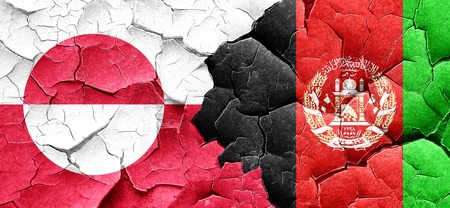 afghan: greenland flag with afghanistan flag on a grunge cracked wall Stock Photo