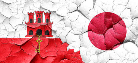 cracked wall: gibraltar flag with Japan flag on a grunge cracked wall Stock Photo