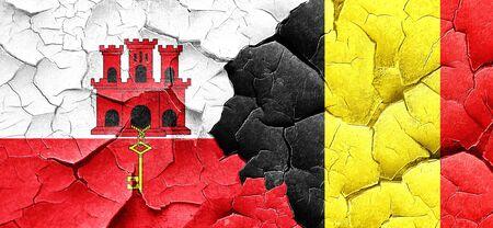 belgium: gibraltar flag with Belgium flag on a grunge cracked wall Stock Photo