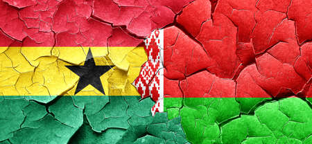 cracked wall: Ghana flag with Belarus flag on a grunge cracked wall Stock Photo