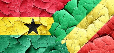 congo: Ghana flag with congo flag on a grunge cracked wall Stock Photo