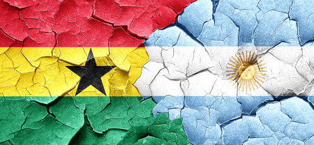argentine: Ghana flag with Argentine flag on a grunge cracked wall