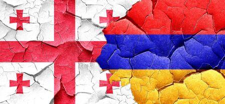 cracked wall: Georgia flag with Armenia flag on a grunge cracked wall Stock Photo