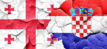 croatia flag: Georgia flag with Croatia flag on a grunge cracked wall Stock Photo