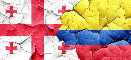 georgia flag: Georgia flag with Colombia flag on a grunge cracked wall Stock Photo