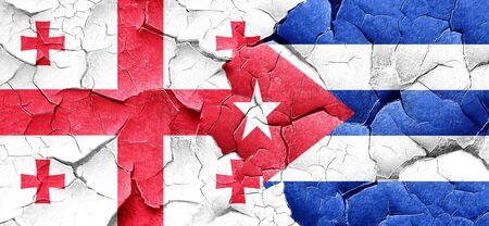 cuba flag: Georgia flag with cuba flag on a grunge cracked wall
