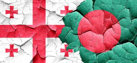 bangladesh: Georgia flag with Bangladesh flag on a grunge cracked wall