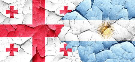 argentine: Georgia flag with Argentine flag on a grunge cracked wall