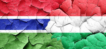 cracked wall: Gambia flag with Hungary flag on a grunge cracked wall