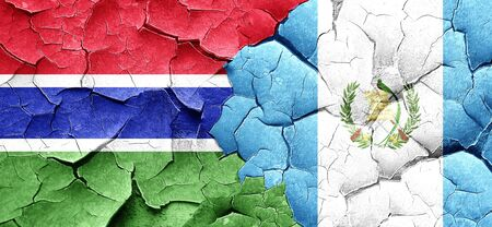 guatemalan: Gambia flag with Guatemala flag on a grunge cracked wall Stock Photo