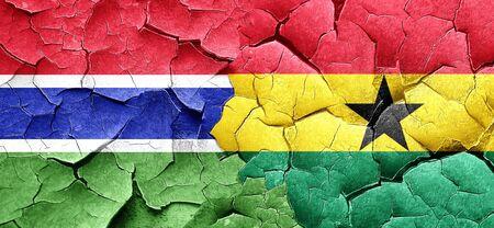 Ghana: Gambia flag with Ghana flag on a grunge cracked wall