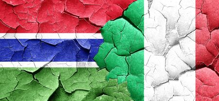 italian politics: Gambia flag with Italy flag on a grunge cracked wall Stock Photo