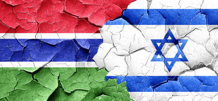 cracked wall: Gambia flag with Israel flag on a grunge cracked wall
