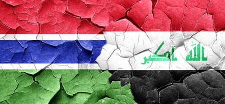 iraq conflict: Gambia flag with Iraq flag on a grunge cracked wall