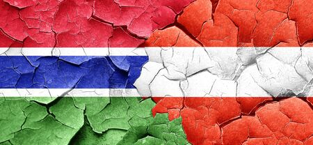 cracked wall: Gambia flag with Austria flag on a grunge cracked wall