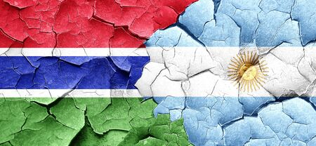 argentine: Gambia flag with Argentine flag on a grunge cracked wall Stock Photo
