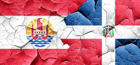 polynesia: french polynesia flag with Dominican Republic flag on a grunge cracked wall
