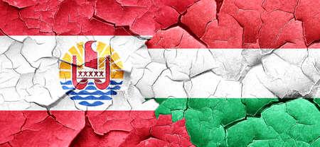 polynesia: french polynesia flag with Hungary flag on a grunge cracked wall