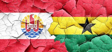 ghanese: french polynesia flag with Ghana flag on a grunge cracked wall