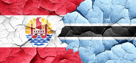 polynesia: french polynesia flag with Botswana flag on a grunge cracked wall Stock Photo