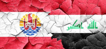 polynesia: french polynesia flag with Iraq flag on a grunge cracked wall
