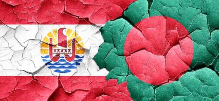 bangladesh: french polynesia flag with Bangladesh flag on a grunge cracked wall