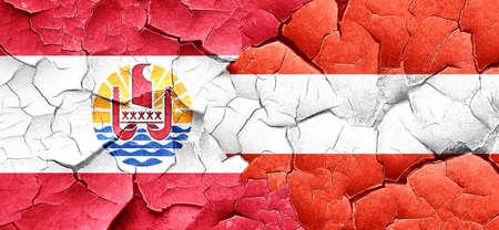polynesia: french polynesia flag with Austria flag on a grunge cracked wall