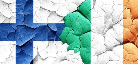 ireland flag: finland flag with Ireland flag on a grunge cracked wall