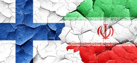 FINLAND flag: finland flag with Iran flag on a grunge cracked wall Stock Photo